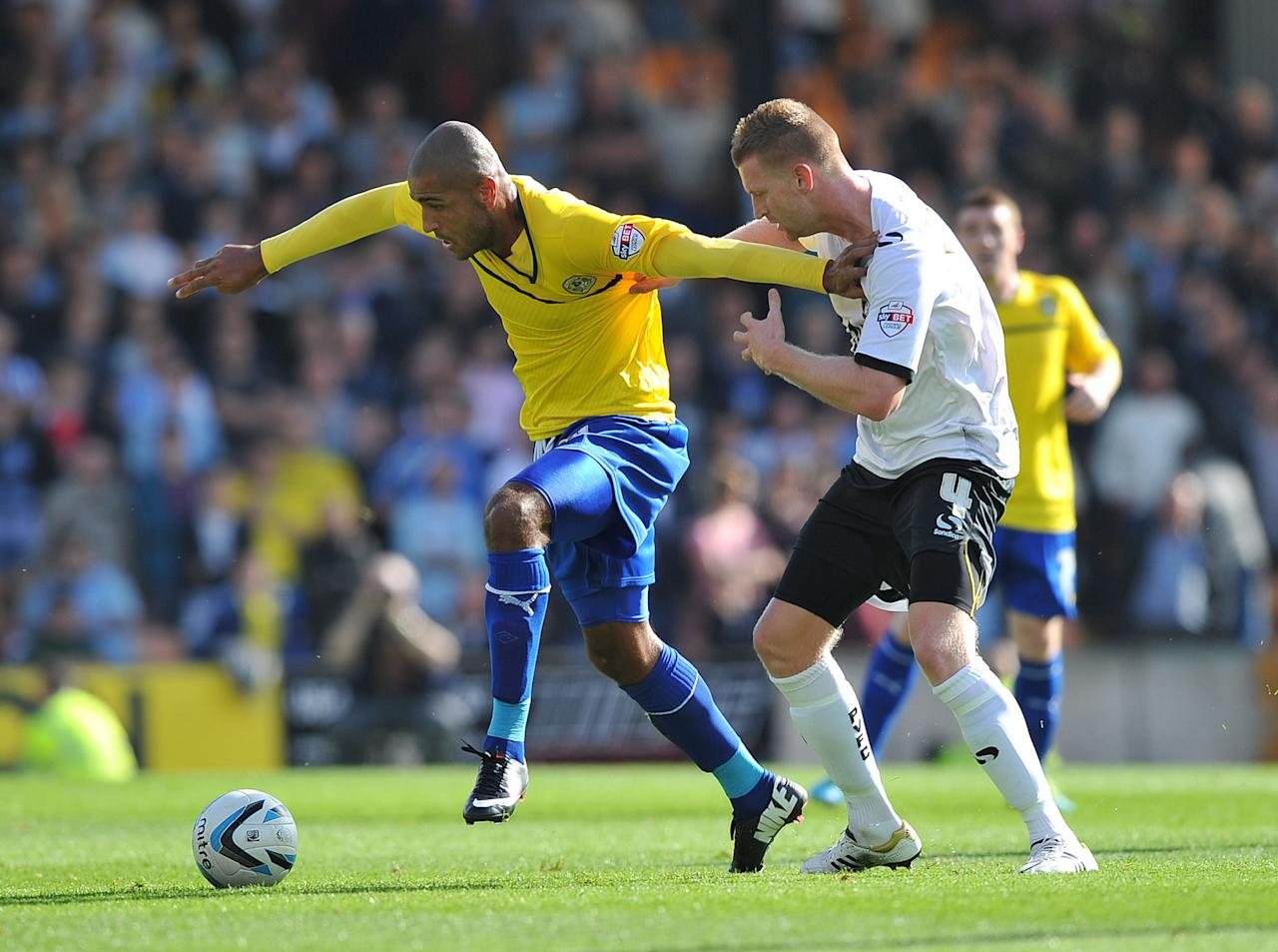 Coventry City's Leon Clarke (left) holds off Port Vale's Chris Robertson (right) during the Sky Bet League One match at Vale Park, Stoke.