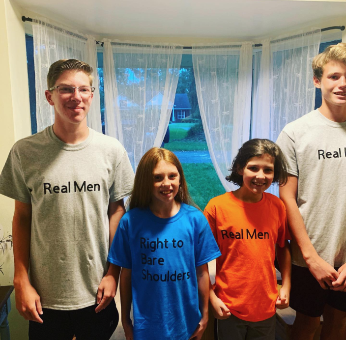 """In response to a dress code violation, students wore t-shirts that read """"right to bare shoulders"""" and """"Real men aren't distracted by shoulders"""" to school. (Photo: Kate Darrow)"""