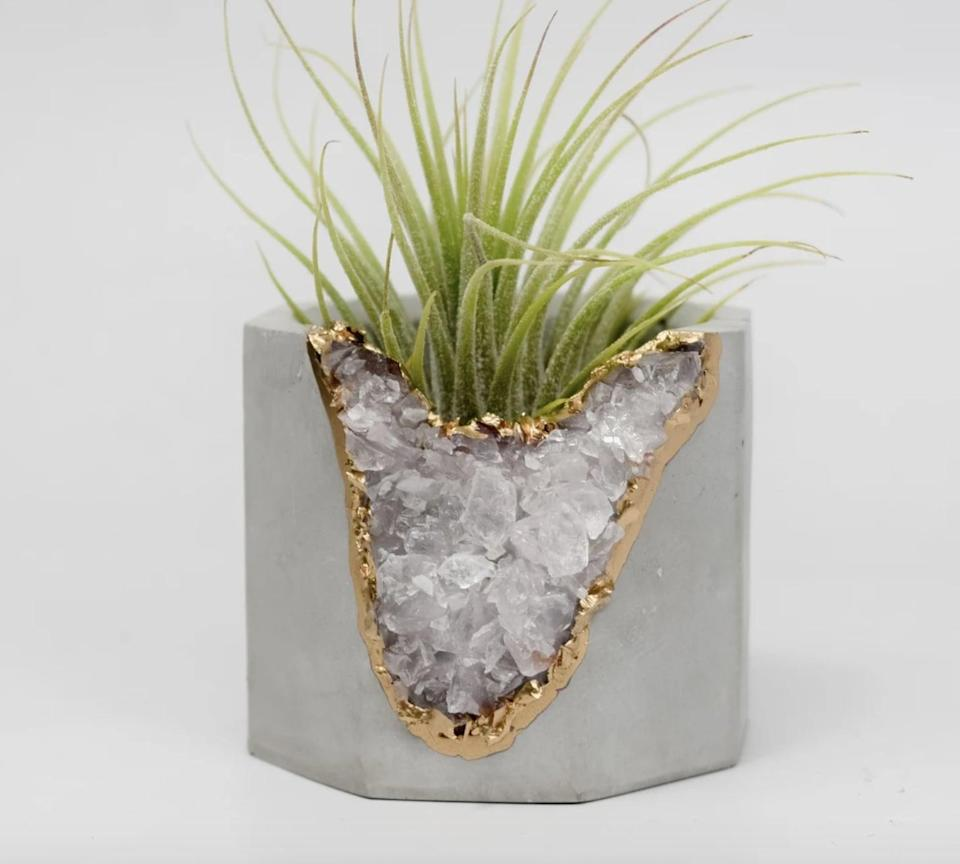 <p>The design of this <span>Tal &amp; Bert Blue Apatite Geode Vessel</span> ($32) is so cool. They'll love to put it on display.</p>