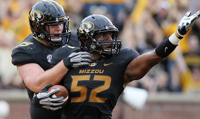 FILE - In this Sept. 1, 2012, file photo, Missouri linebacker Michael Sam (52) is congratulated by teammate Matt Hoch after returning a fumble seven yards for a touchdown against Southeastern Louisiana during the first quarter, in Columbia, Mo. Michael Sam hopes his ability is all that matters, not his sexual orientation. Missouri's All-America defensive end came out to the entire country Sunday night, Feb. 9, 2014, and could become the first openly gay player in America's most popular sport. (AP Photo/Chris Lee, St. Louis Post-Dispatch, File)