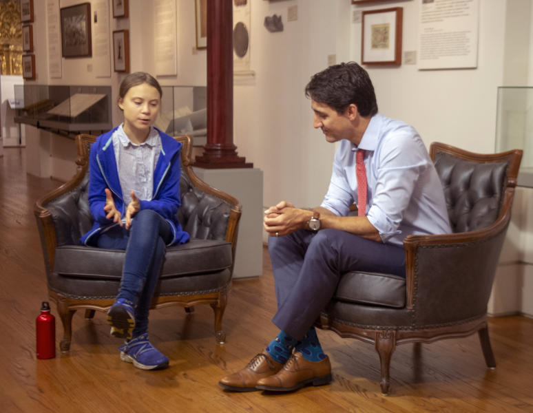 Canadian Prime Minister Justin Trudeau speaks Swedish environmental activist Greta Thunberg in Montreal on Friday, Sept. 27, 2019.  Thunberg says she delivered the same message to Trudeau that she gives to all politicians -- that he needs to listen to the science and act on it. (Ryan Remiorz/The Canadian Press via AP)