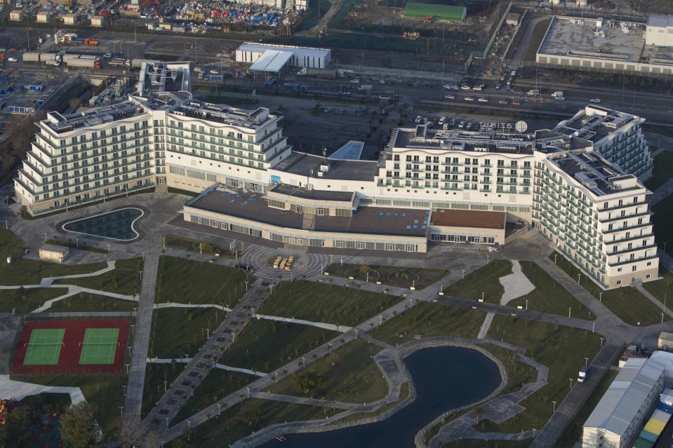 An aerial view from a helicopter shows AZIMUT Hotel Resort and SPA Sochi in the Adler district of the Black Sea resort city of Sochi, December 23, 2013. Sochi will host the 2014 Winter Olympic Games in February. Picture taken December 23, 2013. REUTERS/Maxim Shemetov (RUSSIA - Tags: CITYSCAPE SPORT OLYMPICS TRAVEL)