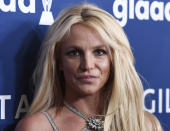 FILE - In this April 12, 2018 file photo Britney Spears arrives at the 29th annual GLAAD Media Awards, in Beverly Hills, Calif. Spears' fight to end the conservatorship that controlled vast aspects of her life is putting the spotlight on ongoing efforts in U.S. states to reform laws that advocates say too often harm the very people they were meant to protect. (Photo by Chris Pizzello/Invision/AP, File)