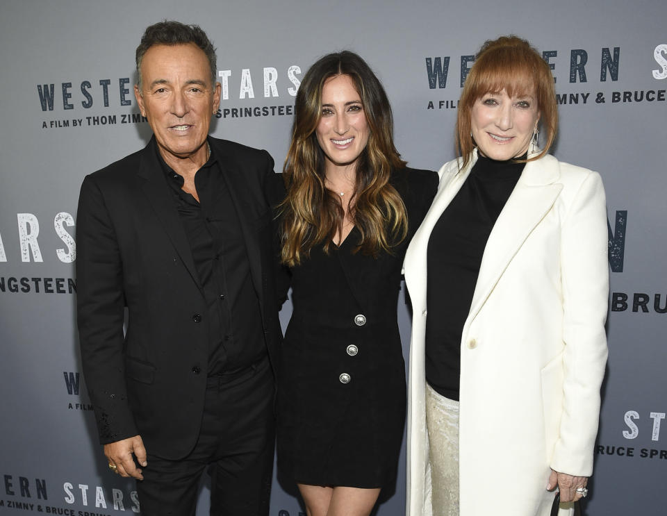 """FILE - Singer-songwriter and co-director Bruce Springsteen, left, daughter Jessica Springsteen, center, and wife Patti Scialfa attend the special screening of """"Western Stars"""" at Metrograph in New York, in this Wednesday, Oct. 16, 2019, file photo. The daughter of rock icon Bruce Springsteen and singer-songwriter Patti Scialfa has been selected as one of four riders on the U.S. jumping team that will compete at the Tokyo Olympics. Twenty-nine-year-old Jessica Springsteen is making her Olympic debut.(Photo by Evan Agostini/Invision/AP, File)"""