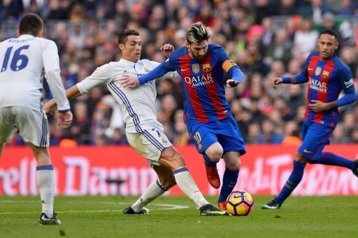 Barcelona's forward Lionel Messi (2ndR) vies with Real Madrid's forward Cristiano Ronaldo during the Spanish league football match December 3, 2016