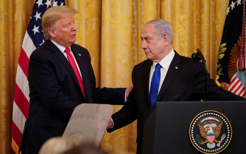 U.S. President Trump and Israel's Prime Minister Netanyahu shake hands announcing Middle East peace proposal at news conference at White House in Washington