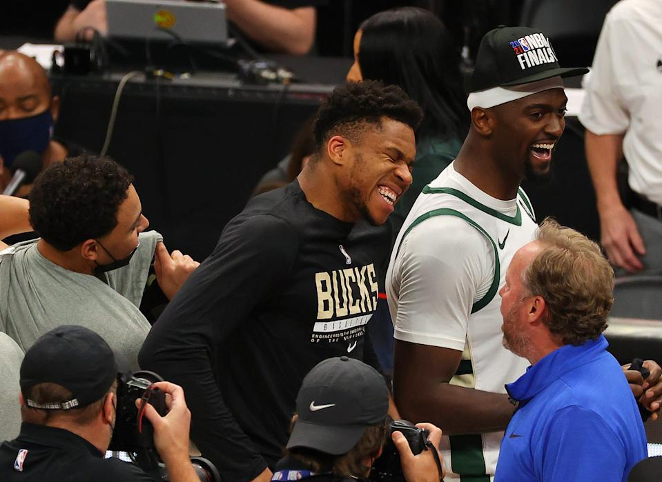 Giannis Antetokounmpo celebrates after the Bucks' Game 6 win over the Hawks.