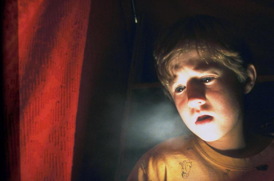 """<p>Haley Joel Osment will forever be known as the kid who told Dr. Malcolm Crowe (Bruce Willis), """"I see dead people,"""" in M. Night Shyamalan's 1990 supernatural thriller. (Photo: Everett)</p>"""