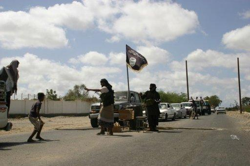 Vehicles stop at a checkpoint set up by Yemeni militants, suspected of being members of  Al-Qaeda, in April