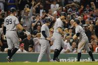 New York Yankees' Giancarlo Stanton, center, celebrates his grand slam that also drove in, from left, Aaron Judge, Anthony Rizzo and Brett Gardner during the eighth inning of a baseball game against the Boston Red Sox, Saturday, Sept. 25, 2021, in Boston. (AP Photo/Michael Dwyer)