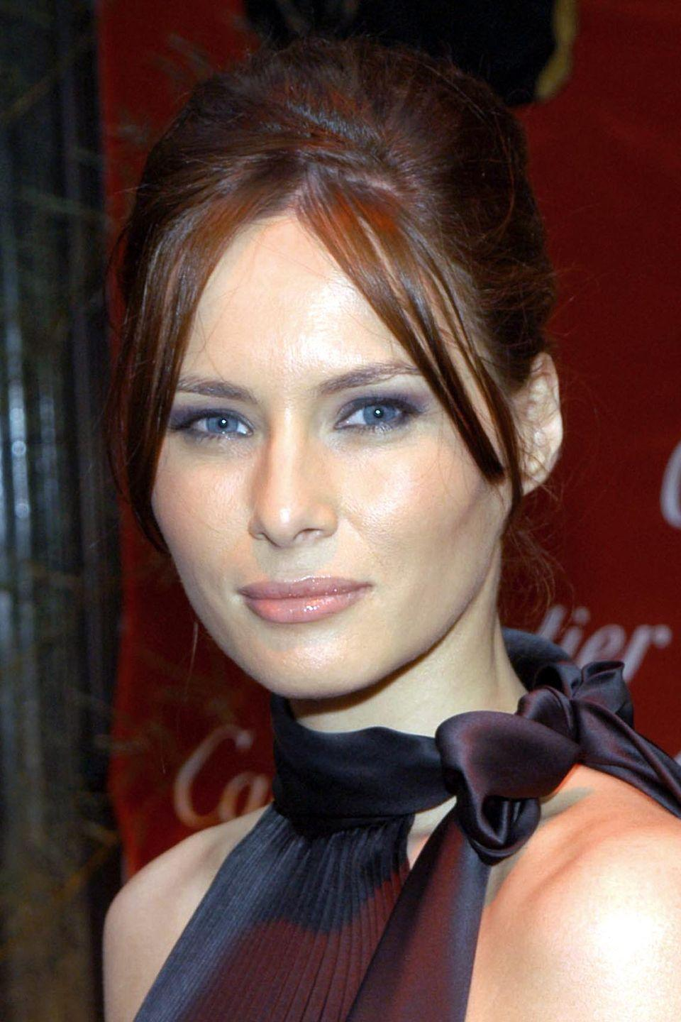 <p>Before going for the super-sunkissed look, the First Lady had a rich brunette shade.</p>