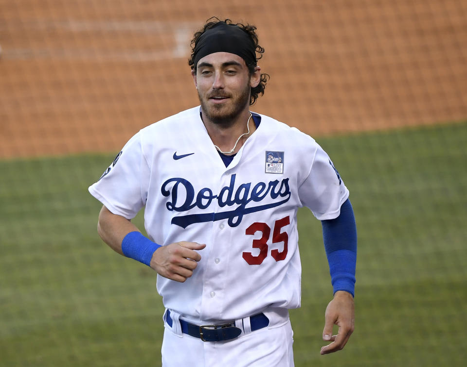 LOS ANGELES, CALIFORNIA - JUNE 02: Cody Bellinger #35 of the Los Angeles Dodgers reacts after scoring his run on a throwing error from Edmundo Sosa #63 of the St. Louis Cardinals, to take a 4-1 lead, during the first inning at Dodger Stadium on June 02, 2021 in Los Angeles, California. (Photo by Harry How/Getty Images)