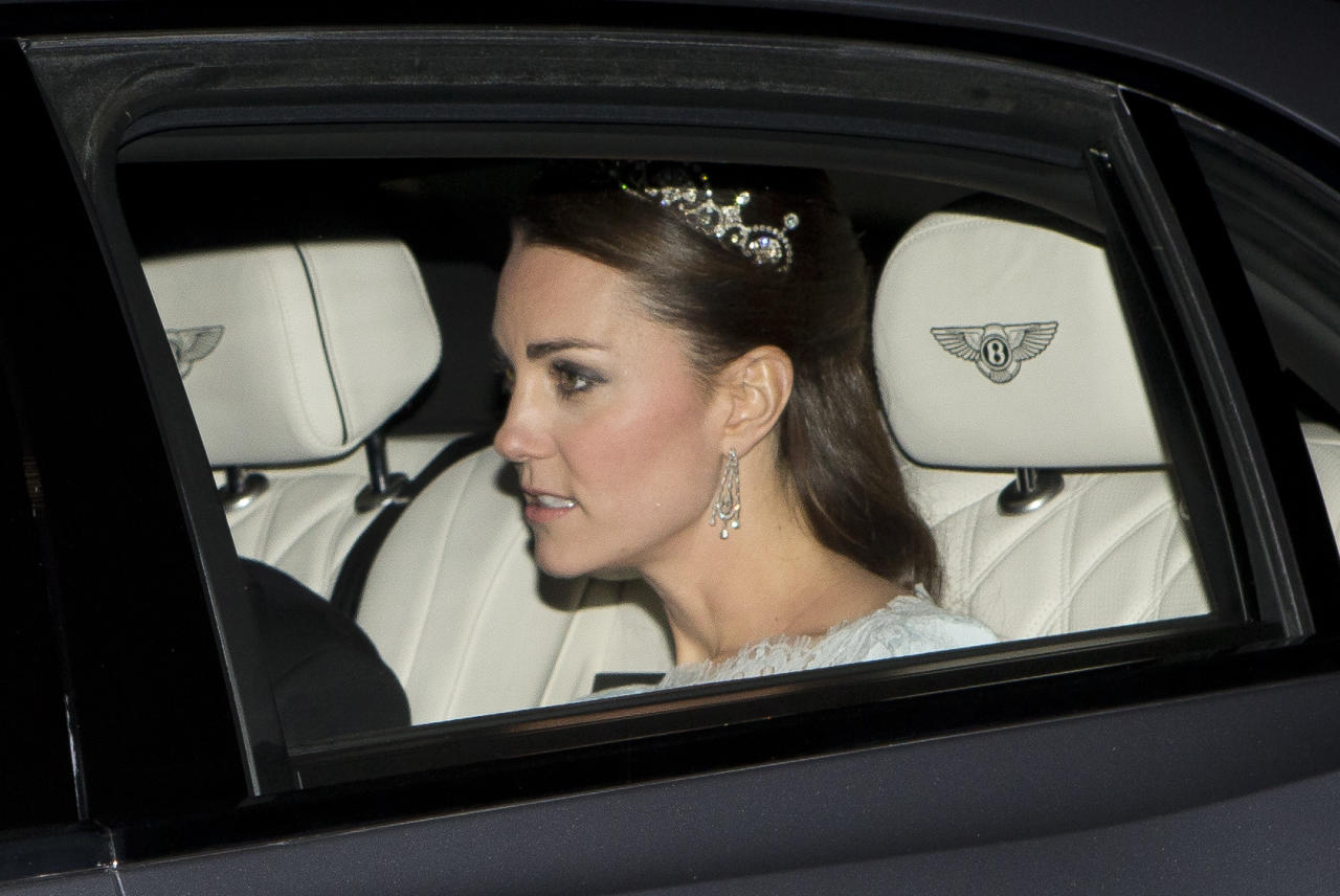 <p>Kate wore the Lotus Flower Tiara with an ice blue Alexander McQueen for the Diplomatic Reception in December 2013. It was the first time we'd seen her in a tiara since her wedding. It once belonged to the Queen Mother and was originally a necklace, that was made into a headpiece by Garrard. The Queen Mother gave it to her daughter Princess Margaret in 1959, who wore it on numerous occasions throughout her life (Splash) </p>