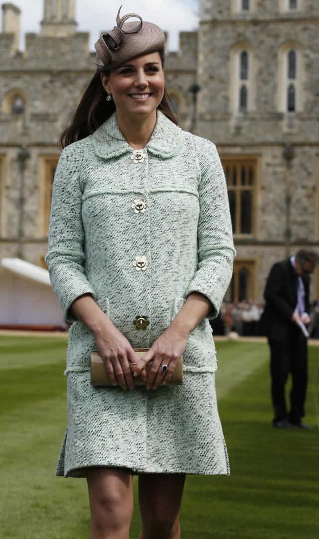 <p>Kate went high-fashion during her first pregnancy, attending an event at Windsor Castle in a mint green Mulberry coat. (Photo: PA) </p>