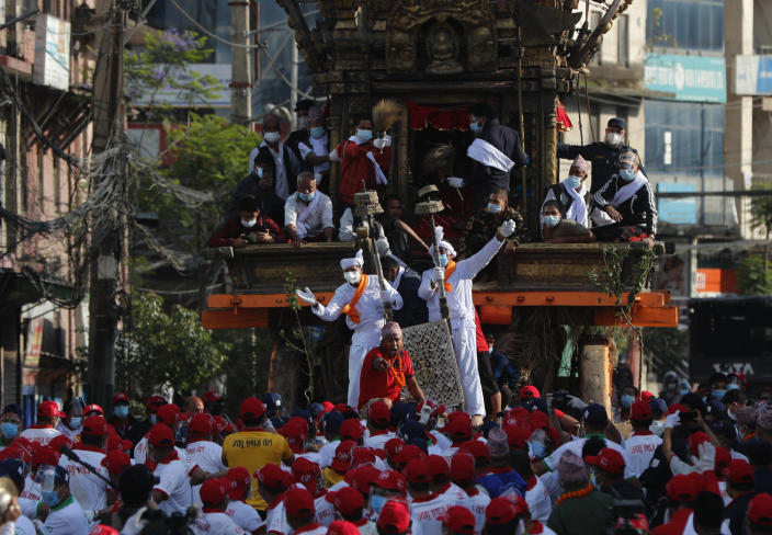 Nepalese devotees pull a chariot during the Rato Machindranath chariot festival in Lalitpur, Nepal, Saturday, May 15, 2021. A truncated version of a Hindu chariot festival took place in Nepal's capital on Saturday amid strict COVID-19 restrictions, following an agreement between organizers and authorities that prevented a repeat of violent confrontations between police and protesters at last year's festival. (AP Photo/Niranjan Shrestha)