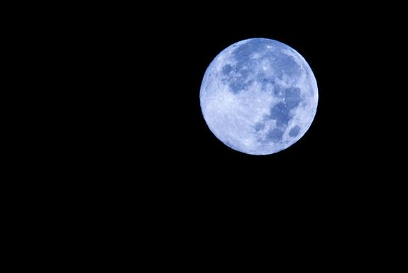 Night sky watcher Tomsajinsa sent in this photo of the blue moon taken in NYC, August 31, 2012.