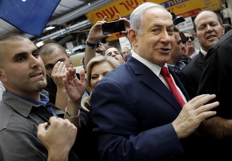 Netanyahu makes his way through Machane Yehuda market in Jerusalem the day before the election (AFP Photo/THOMAS COEX)