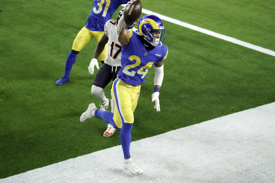 Los Angeles Rams safety Taylor Rapp (24) celebrates after intercepting a pass in the end zone during the second half of an NFL football game against the Chicago Bears Monday, Oct. 26, 2020, in Inglewood, Calif. (AP Photo/Ashley Landis)