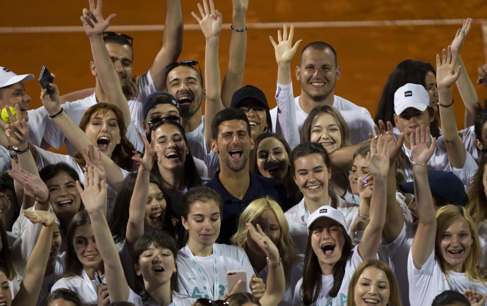 BELGRADE, SERBIA - JUNE 14: Novak Djokovic of Serbia posing for photographers with tournament volunteers on June 14, during the 3rd day of Summer Adria Tour, 2020 in Belgrade, Serbia. (Photo by Nikola Krstic/MB Media/Getty Images)