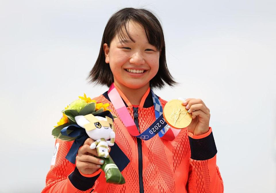 """Momiji Nishiya of Team Japan poses with her gold medal during the Women's Street Final medal ceremony on day three of the Tokyo 2020 Olympic Games at Ariake Urban Sports Park on July 26, 2021 in Tokyo, Japan.<span class=""""copyright"""">Patrick Smith—Getty Images</span>"""