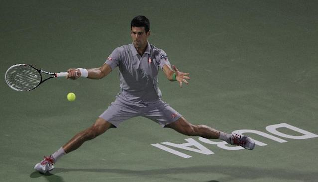 Novak Djokovic of Serbia returns the ball to Roger Federer of Switzerland during a semi final match of the Dubai Duty Free Tennis Championships in Dubai, United Arab Emirates, Friday, Feb. 28, 2014. (AP Photo/Kamran Jebreili)