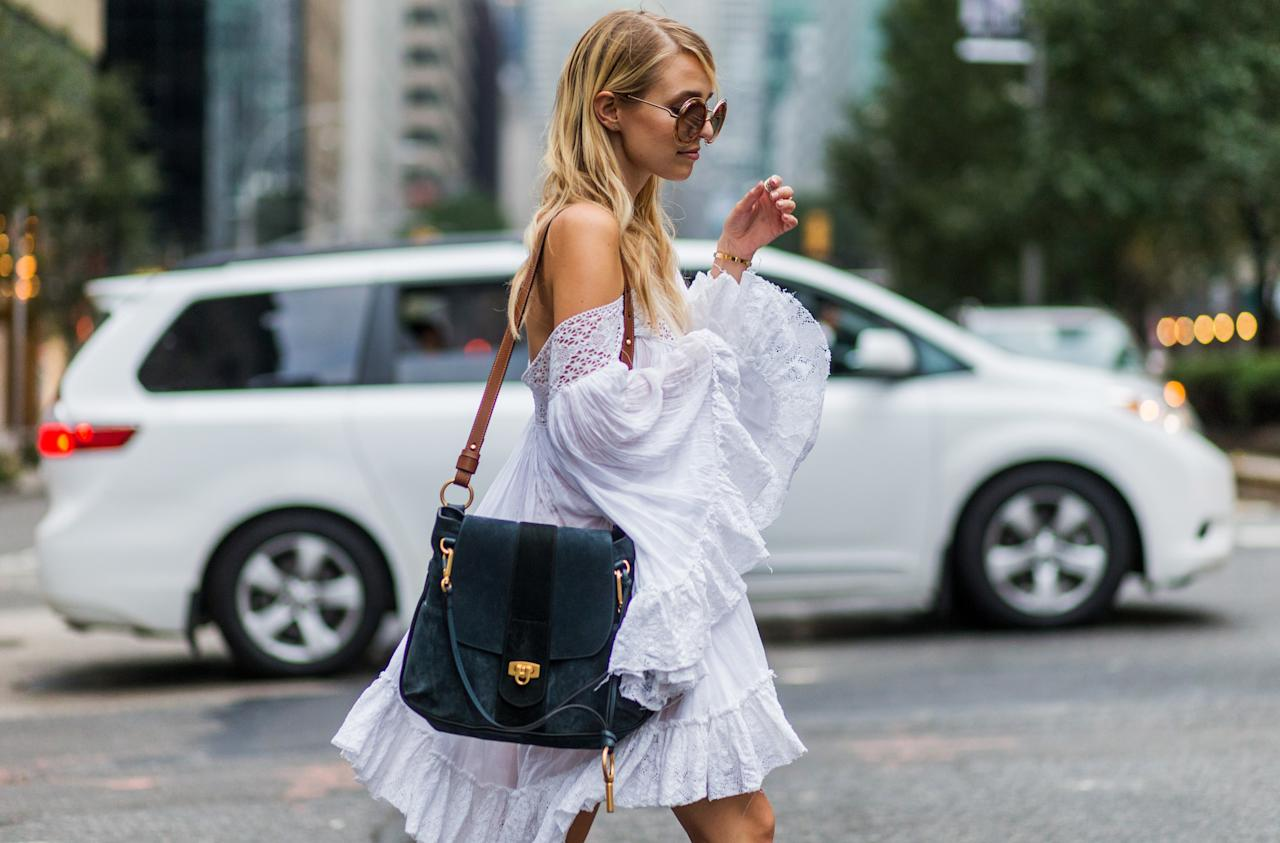 <p>Floaty off-the-shoulder dresses and rompers definitely had their moments in Coachella seasons' past, but with some updated styling, they can be better than ever. Our top accessory picks? A pair of big sunnies, large sparkly earrings, and a fun fringe bag (a little bit of fringe goes a long way).</p>