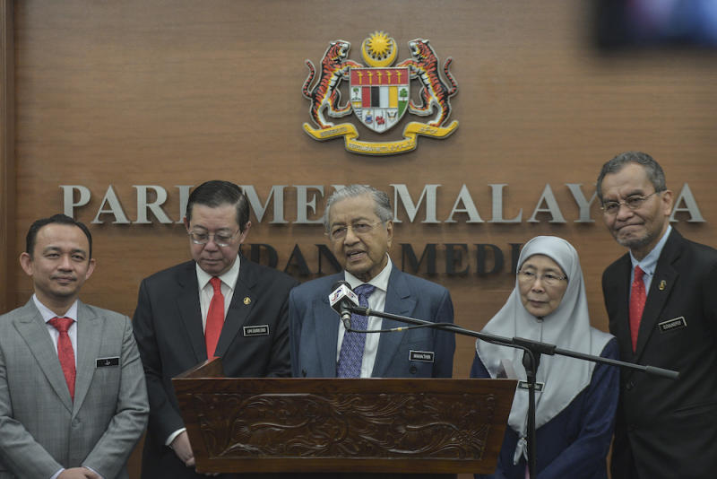 Prime Minister Tun Dr Mahathir Mohamad speaks to reporters in Parliament October 11, 2019, after the tabling of Budget 2020. — Picture by Shafwan Zaidon