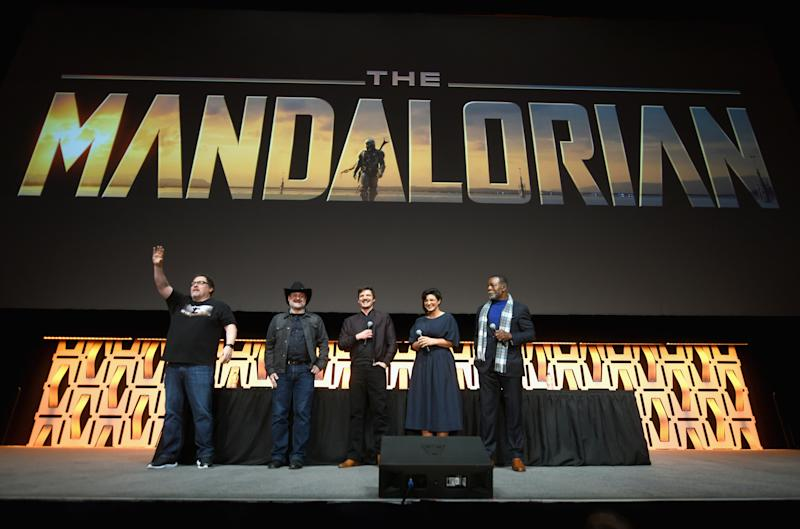 "CHICAGO, IL - APRIL 14: (L-R) Writer/executive producer Jon Favreau, Director/executive producer Dave Filoni, Pedro Pascal (The Mandalorian), Gina Carano (Cara Dune) and Carl Weathers (Greef) onstage during ""The Mandalorian"" panel at the Star Wars Celebration at McCormick Place Convention Center on April 14, 2019 in Chicago, Illinois. (Photo by Daniel Boczarski/WireImage for Disney)"