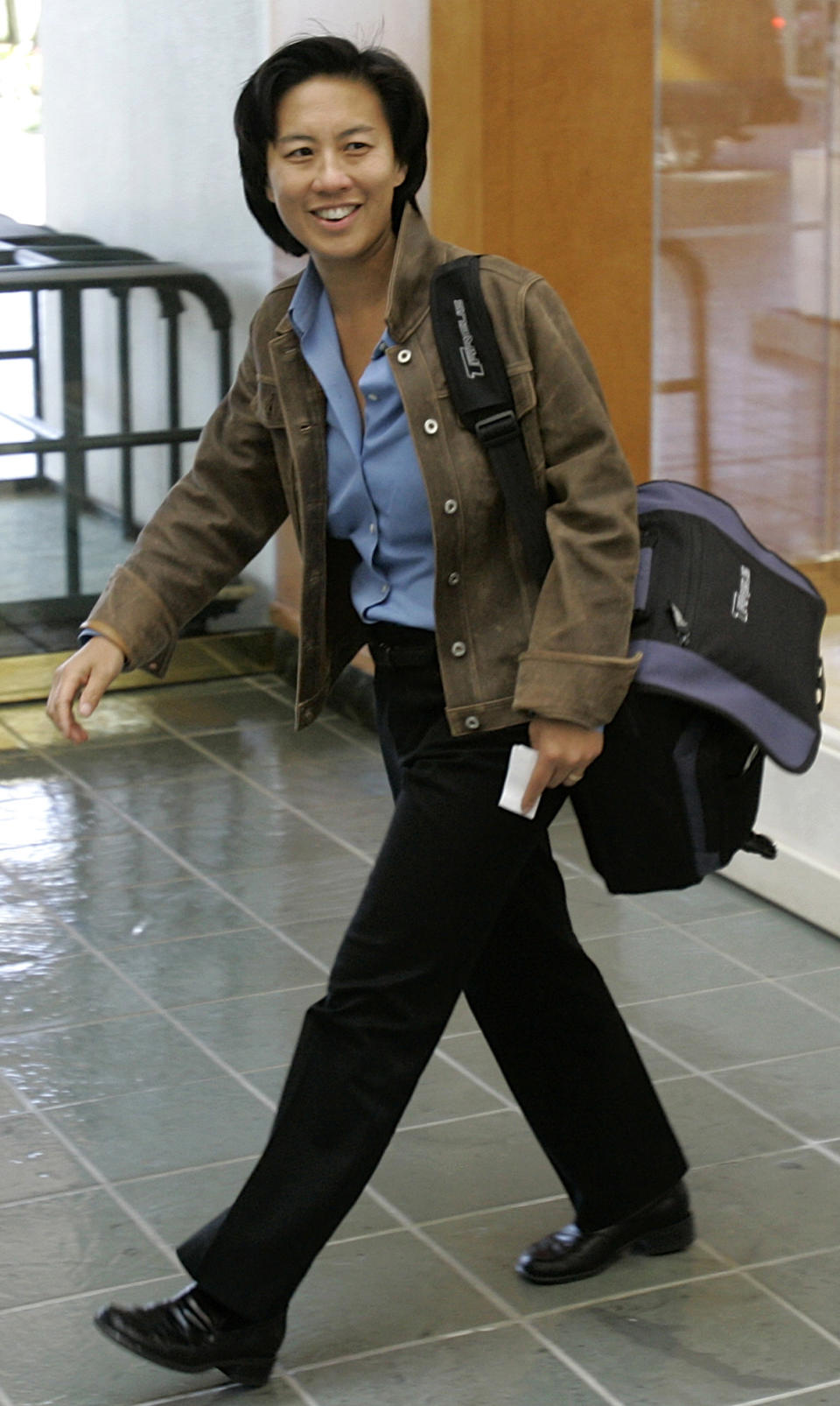 ** FILE ** Los Angeles Dodgers assistant general manager Kim Ng walks through the hotel lobby during the first day of Major League Baseball annual general managers meetings in Orlando, Fla., in this Nov. 5, 2007 file photo. (AP Photo/John Raoux, file)