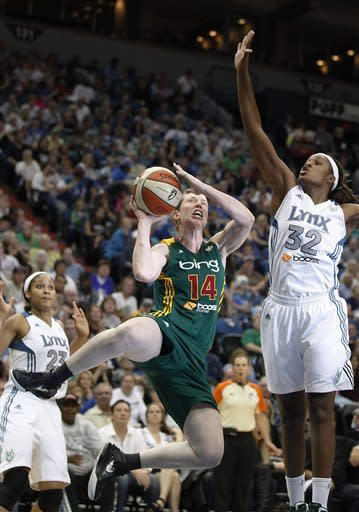 Seattle Storm guard Katie Smith (14) goes up to the basket against Minnesota Lynx forward Rebekkah Brunson (32) during the second half of Game 1 of the WNBA basketball first-round playoff series Friday, Sept. 28, 2012, in Minneapolis. The Lynx won 78-70. (AP Photo/Stacy Bengs)