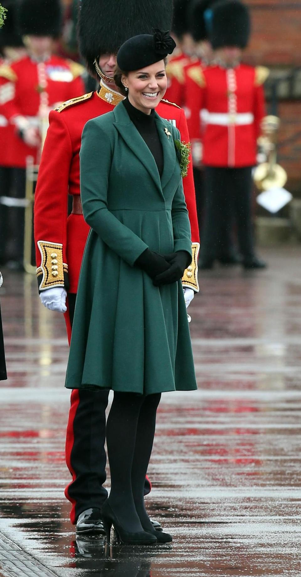 <p>In 2013, despite being pregnant with Prince George, Kate slipped into the same Emilia Wickstead coat she had worn the year before. She layered the look with a black high neck top, and accessorised with a black hat and Emmy London pumps. <em>[Photo: PA]</em> </p>