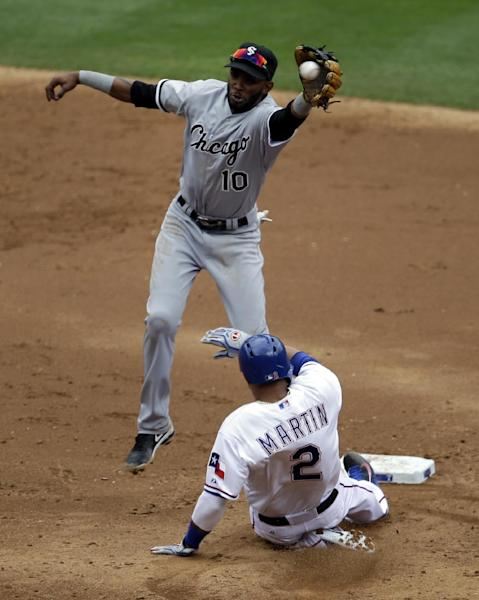 Texas Rangers' Leonys Martin (2) steals second as Chicago White Sox shortstop Alexei Ramirez (10) goes up for a high throw to the bag in the third inning of a baseball game, Sunday, April 20, 2014, in Arlington, Texas. (AP Photo/Tony Gutierrez)