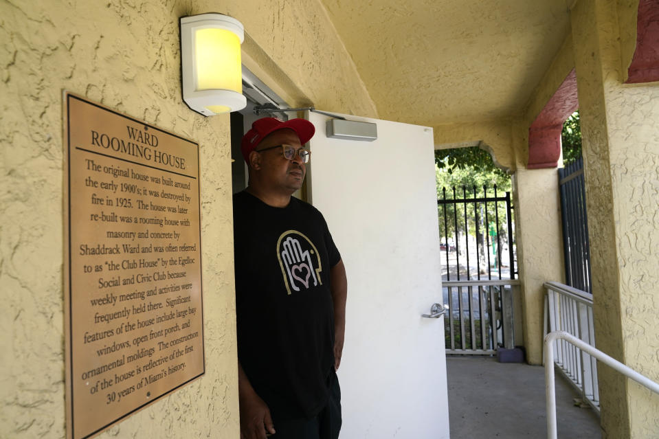 """Chris Norwood, founder of the Hampton Art Lovers, poses for a photograph at the historic Ward Rooming House art gallery in the Overtown neighborhood of Miami, Wednesday, June 2, 2021. The historic Ward Rooming House, built in 1925, once served as a rooming house for Black and Native American people during segregation. The gallery has had success getting Black people to come back to Overtown as a cultural destination, Norwood said, adding: """"They come to a place that is holy for them."""" (AP Photo/Lynne Sladky)"""