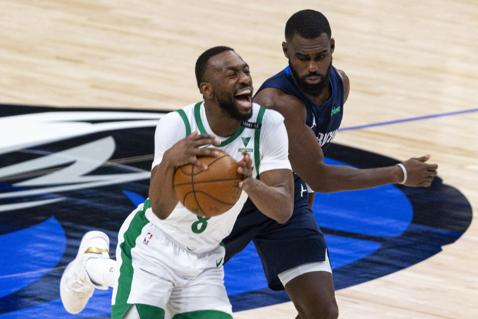 Boston Celtics guard Kemba Walker (8) reacts after being fouled by Dallas Mavericks forward Tim Hardaway Jr. during the first half of an NBA basketball game in Dallas, Tuesday, Feb. 23, 2021. (AP Photo/Sam Hodde)