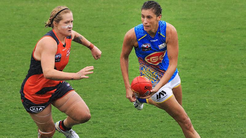 Jasmine Hewett, pictured here running with the ball against Greater Western Sydney Giants in the AFLW.