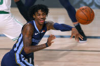 Memphis Grizzlies' Ja Morant passes the ball during the second half of an NBA basketball game against the Boston Celtics Tuesday, Aug. 11, 2020, in Lake Buena Vista, Fla. (AP Photo/Mike Ehrmann, Pool)