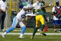 Detroit Lions' Will Harris is called for a horsecollar penalty on his tackle of Green Bay Packers' Davante Adams during the first half of an NFL football game Sunday, Sept. 20, 2020, in Green Bay, Wis. (AP Photo/Morry Gash)