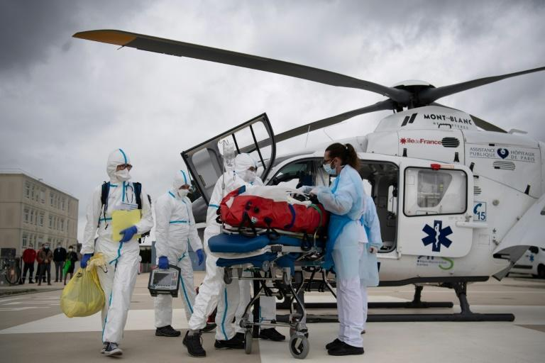 With hospitals pushed to their limits and transferring some patients by helicopter, France has again tightened restrictions even as vaccinations get back underway