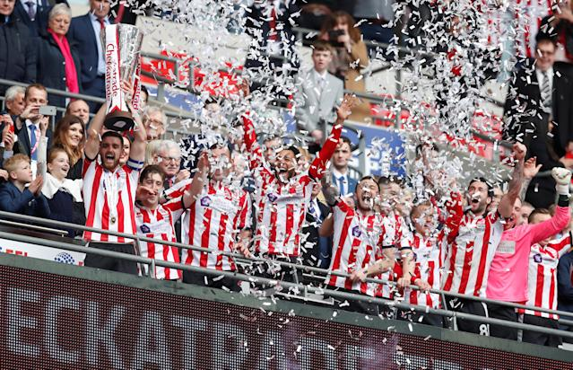 "Soccer Football - Checkatrade Trophy Final - Lincoln City vs Shrewsbury Town - Wembley Stadium, London, Britain - April 8, 2018 Lincoln CityÕs Luke Waterfall lifts the trophy after winning the Checkatrade Trophy Final Action Images/Matthew Childs EDITORIAL USE ONLY. No use with unauthorized audio, video, data, fixture lists, club/league logos or ""live"" services. Online in-match use limited to 75 images, no video emulation. No use in betting, games or single club/league/player publications. Please contact your account representative for further details."