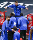 Dallas Mavericks guard Luka Doncic celebrates on the bench as the second half of an NBA basketball game against the Cleveland Cavaliers comes to an end, Friday, May 7, 2021, in Dallas. (AP Photo/Brandon Wade)