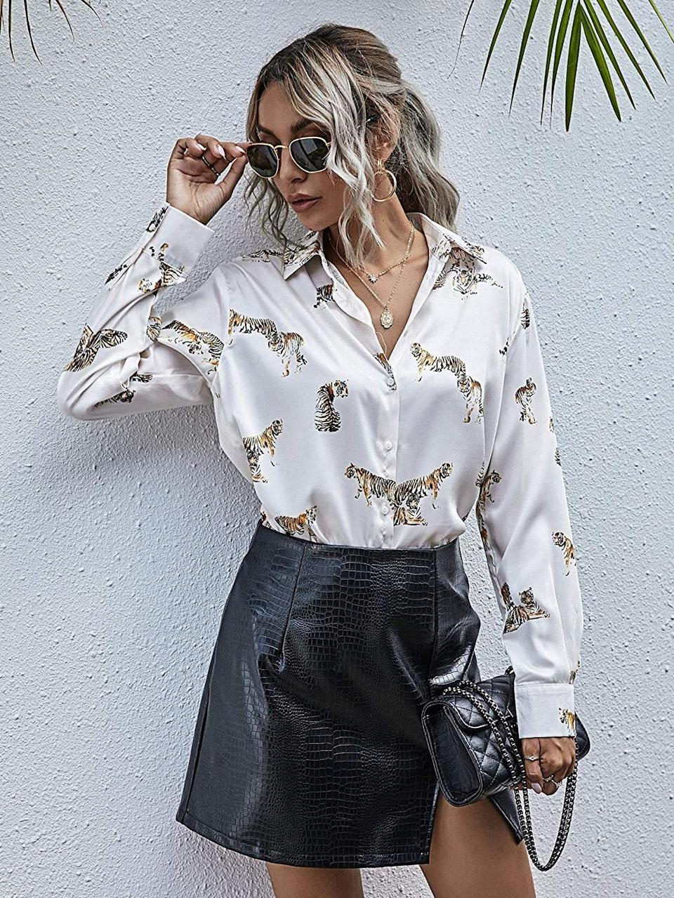 """If you're sick of drowning under bulky sweaters, this is perfect for you. This silky number only looks three-dollar-signs fancy, and the moment you slip it on? You might just be mistaken for an influencer.<br /><br /><strong>Promising review:</strong>""""Wow! I never write reviews and honestly, I never got anything great on Amazon but this top is fantastic! It was inexpensive but does not look cheap, the golden color is beautiful. I could have gone down a size but it's fine I will be tucking in... beautiful soft blouse I'm very happy with this purchase!"""" —<a href=""""https://www.amazon.com/gp/customer-reviews/RJ6E6HSFYQZ47?&linkCode=ll2&tag=huffpost-bfsyndication-20&linkId=de7132105ac6b474f5b3d513585d4cb2&language=en_US&ref_=as_li_ss_tl"""" target=""""_blank"""" rel=""""nofollow noopener noreferrer"""" data-skimlinks-tracking=""""5925990"""" data-vars-affiliate=""""Amazon"""" data-vars-href=""""https://www.amazon.com/gp/customer-reviews/RJ6E6HSFYQZ47?tag=bfjasminsandal-20&ascsubtag=5925990%2C6%2C36%2Cmobile_web%2C0%2C0%2C16625403"""" data-vars-keywords=""""cleaning,fast fashion"""" data-vars-link-id=""""16625403"""" data-vars-price="""""""" data-vars-product-id=""""21064103"""" data-vars-product-img="""""""" data-vars-product-title="""""""" data-vars-retailers=""""Amazon"""">Alex Velez</a><br /><br /><a href=""""https://www.amazon.com/SOLY-HUX-Womens-Sleeve-Button/dp/B07VT2ZWJ9?&linkCode=ll1&tag=huffpost-bfsyndication-20&linkId=6795bac1395f66858e93fa71c3cf8433&language=en_US&ref_=as_li_ss_tl"""" target=""""_blank"""" rel=""""noopener noreferrer""""><strong>Get it from Amazon for$11.99+(available in sizes XS-XL and 34 colors).</strong></a>"""