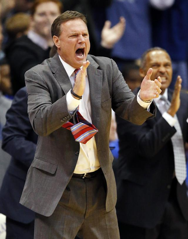 Kansas head coach Bill Self cheers his on his team's defense during the first half of an NCAA college basketball game against Kansas State in Lawrence, Kan., Saturday, Jan. 11, 2014. (AP Photo/Orlin Wagner)