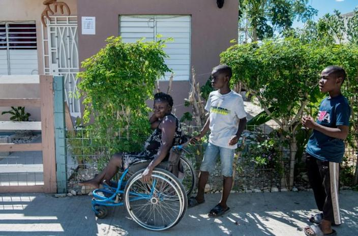 Herlande Mitile has relied on her daughters and their neighbors to help her get by in the aftermath of Haiti's devastating quake (AFP Photo/CHANDAN KHANNA)