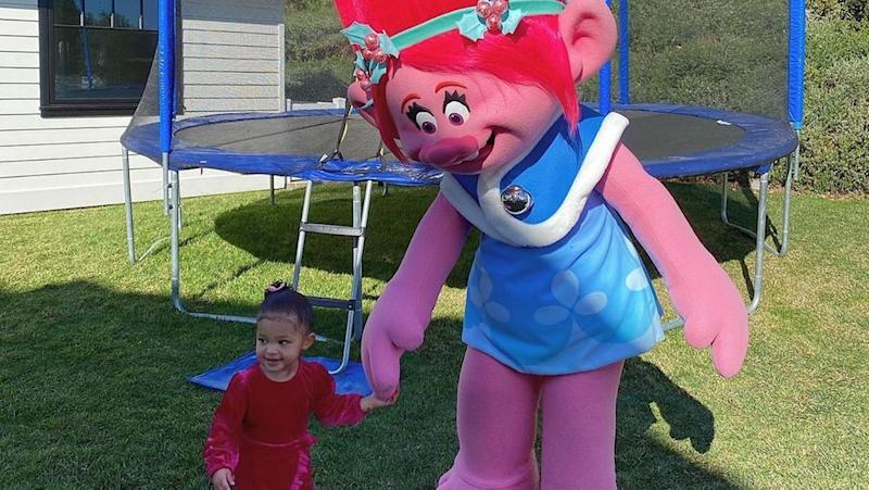 """Stormi plays with a life-size """"Trolls"""" character"""