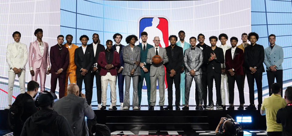 NBA commissioner Adam Silver, center, poses for a photo with players projected to be first round draft picks before the NBA basketball draft, Monday, July 19, 2021, in New York. (AP Photo/Corey Sipkin)