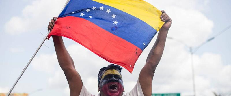 Caracas, Miranda/Venezuela - February 2nd 2019: Demonstrators rally in support of EU's decision to recognize Venezuela's National Assembly President Juan Guaido