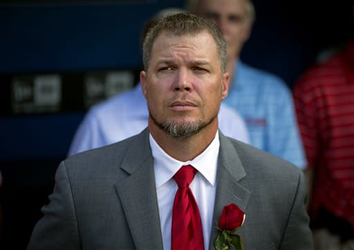 Former Atlanta Braves' Chipper Jones stands in the dugout for the National Anthem before a pregame ceremony retiring his number at a baseball game between the Atlanta Braves and the Arizona Diamondbacks, Friday, June 28, 2013, in Atlanta. (AP Photo/David Goldman)