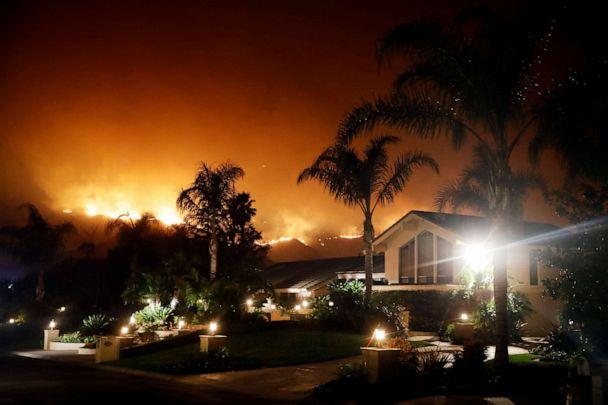 PHOTO: The Maria Fire creates a glow over The Saticoy Country Club, Nov. 1, 2019, in Somis, Calif. (Marcio Jose Sanchez/AP)