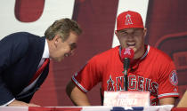 Los Angeles Angels owner Arte Moreno, left, laughs next to center fielder Mike Trout during a news conference to talk about Trout's 12-year $426.5 million contract prior to a preseason baseball game against the Los Angeles Dodgers, Sunday, March 24, 2019, in Anaheim, Calif. (AP Photo/Mark J. Terrill)