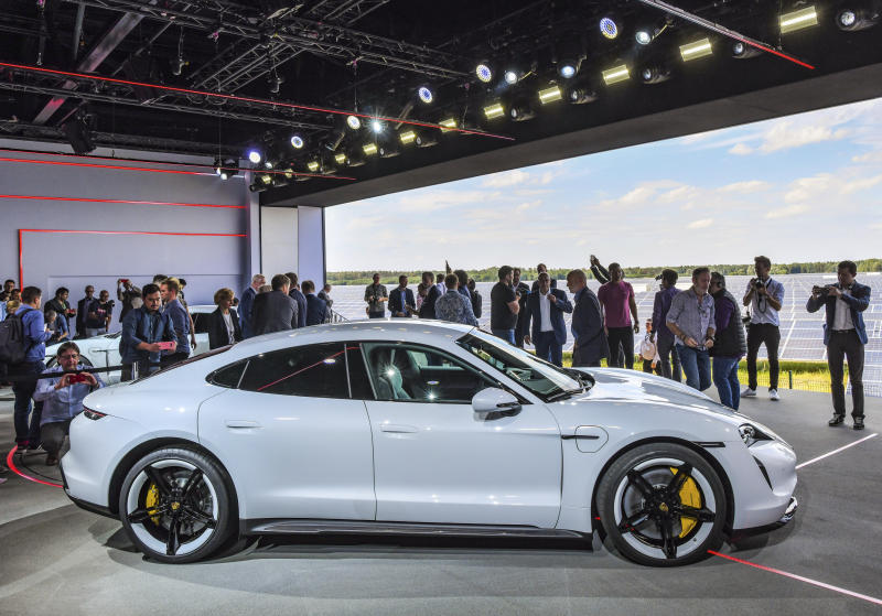 The Porsche Taycan, the first purely electric driven car of the German car maker, is present during a world premier event at the airport Neuhardenberg, about 70 kilometers (45 miles) east of Berlin, Wednesday, Sept. 4, 2019.  (Patrick Pleul/dpa via AP)